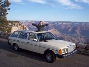 Our 300TDT Wagon in front of the Grand Canyon with my lovely wife popping through the sun roof.