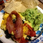 Cheezy Eggs w/ Red Sweet Peppers, Mushrooms, and Black Olives, a side of home-made guacamole, and Tortilla Chips
